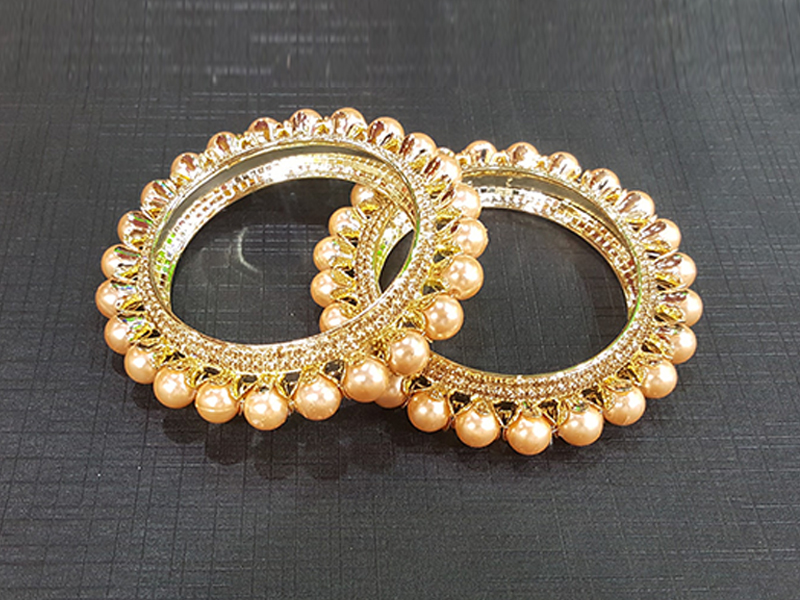 2 Piece Golden Pearl Gold Plated Imitation Churee Set
